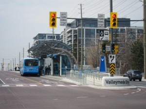 York Region Viva bus at Rapidway stop on Hwy 7, with densification in the background